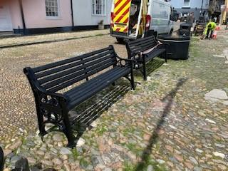 Two of the new heritage style benches on the cobbled street at Bayards Cove