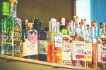 A shelf full of bottles of alcohol