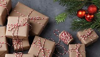 Christmas presents wrapped in brown paper and tied with red and white stripy string