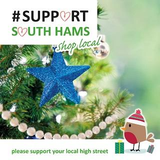 "A image of a Christmas tree decorated with a blue star and the message ""Support South Hams - shop local"""