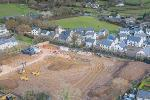 South Brent village with building area under construction in the middle showing bulldozers and a crane