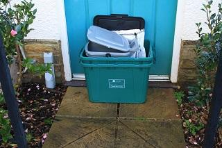 New waste containers being delivered to a doorstep in the South Hams.
